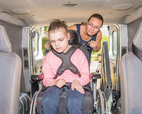 Girl in wheelchair in a car
